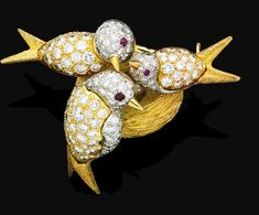 A diamond and ruby brooch, by Tiffany & Co.,