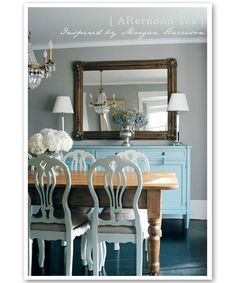 Beautiful dining room from Bandelle Blog! farmhouse dining table, blue chairs, blue buffet, mirror and crystal chandelier.