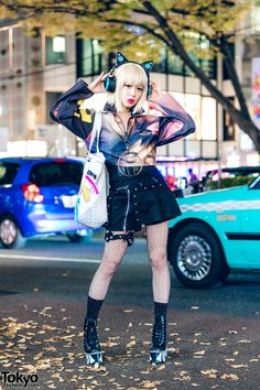 Kyoto J-Pop singer Asachill on the street in Harajuku wearing a colorful print jacket by the Japanese streetwear brand MYOB NYC, with black shorts, fishnet Asian Street Style, Tokyo Street Style, Japanese Street Fashion, Tokyo Fashion, Harajuku Fashion, Kawaii Fashion, Pop Fashion, Korean Fashion, Street Styles