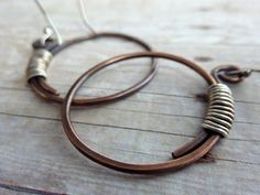 Copper Hoop Earrings Rustic Wire Wrapped Sterling Silver Boho Mixed Metal by ATwistOfWhimsy on Etsy https://www.etsy.com/listing/150628688/copper-hoop-earrings-rustic-wire-wrapped
