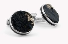A unique rough stone is captured within a thin silver case. The Lapis originates from Afganistan. Each cufflink features an enamel stripe around the edge, matching the colour of the stone. A classic yet contemporary piece in vibrant colours.