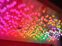 Rainbow lights! could be awesome DIY. Easy with RBG LEDs & ping pong balls.  May be too much work unless also made to be reused at other events. Maybe lighting for dome?