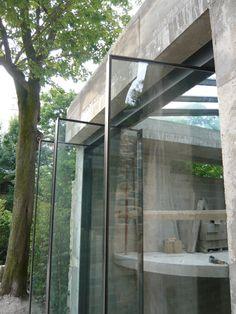Pivot doors with narrow frames by Vitrocsa