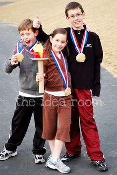 olympic torch and medals - gold foil wrapped cookie for medals. May use a sparkler for a torch though.
