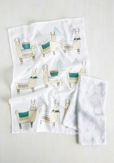 Turn capers in the kitchen into a true treat by using these cotton towels while baking away! Featuring a darling llama print in white, teal, and taupe hues, this quirky textile assures you always have a cute reason to hoof it back to the galley!