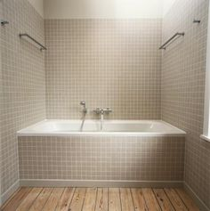 How to Tile a Plastic Tub - because the right tiling can be classy!