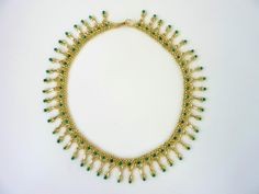 DIY Jewelry: Free beading pattern for necklace Bugle Fringes, made with any length bugle beads with fringe beads and seed beads. Very lovely!