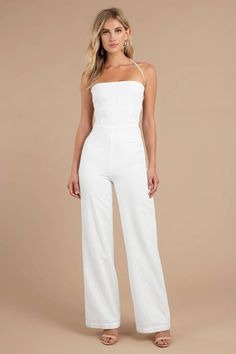 The Knock Out White Halter Jumpsuit features a textured cotton weave with a back lace-up closure, elastic waistband, and lined bottom! Halter Jumpsuit, White Jumpsuit, Denim Jumpsuit, Long Jumpsuits, Jumpsuits For Women, Rehearsal Dinner Outfits, Shower Outfits, Wedding Jumpsuit, Trendy Dresses