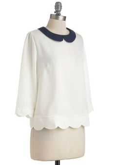 """I don't know if its the collar or the scalloped edges but this shirt is TOO CUT this shirt says """"i would look really good with that skirt a few rows down that has the little flowers or whatever on it and its kind of a navy color mmm""""  Dream Home Top in White, #ModCloth"""