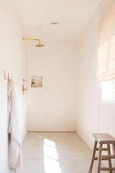 pale pink plaster walled shower