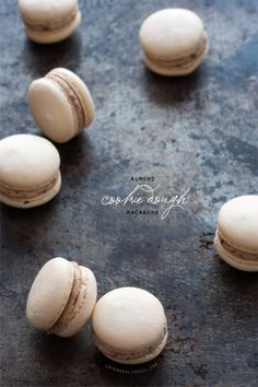 Almond Cookie Dough Macarons with an almond and shaved chocolate (eggless!) cookie dough filling