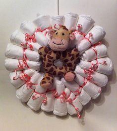 20 new born nappies with a giraffe rattler. All Gifts, Future Children, Giraffe, Christmas Wreaths, Arts And Crafts, Holiday Decor, Baby, Felt Giraffe, Giraffes