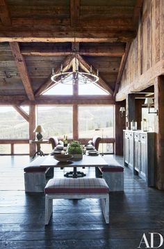 A trestle table and benches anchor the dining space of this Montana lodge, created by architect Paul Bertelli and decorator Markham Roberts. Dining Room Bench, Dining Room Design, Dining Area, Dining Rooms, Kitchen Design, Small Dining, Dining Tables, Fine Dining, Architectural Digest