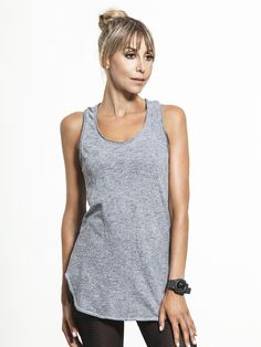 Want a little more coverage from your tank? This Racerback Tunic top from Lanston is just what you've been searching for. With an extended hem length and a relaxed fit, this heathered top is perfect for layering or as an easy cover-up before your next workout.