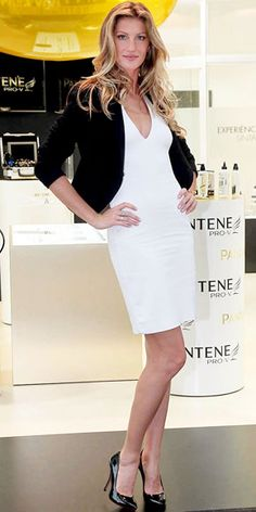 Gisele Bundchen  WHAT SHE WORE  Gisele Bundchen helped open Brazil's Pantene Institute Experience in a blazer-topped dress and pointy-toe heels.