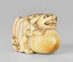 ivory netsuke of a shishi. Late 18th/early 19th century
