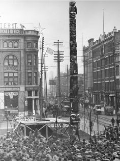"The ""Stolen Totem"" at its 1899 Pioneer Place dedication. Wilse took the photo, and the Seattle Good Willl Committee while on its cruise to and back from Alaska during the gold rush, took the totem pole off of Tongass Island. Seattle Underground Tour, Snoqualmie Falls, Evergreen State, Tlingit, Seattle Washington, Washington State, Native American History, American Indians, Old Photos"
