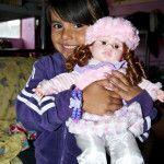 Loves her doll and bracelet!