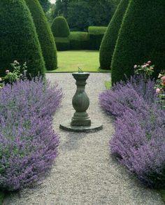 Formal garden, boxwood, pea gravel, garden statuary, sun dial, topiary, lavender, European style garden