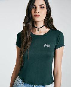 <p>This cute t-shirt features a super soft knit body, a bicycle embroidered at the front, and a short fit.</p>    <p>Model wears a size small.</p>    <ul>  <li>Crew Neckline</li>  <li>Short Sleeves</li>  <li>Unlined</li>  <li>Rayon / Spandex</li>  <li>Machine Wash</li>  <li>Imported</li>  </ul>