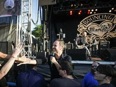 Bouncing Souls frontman Greg Attonito steps offstage to greet his fans on July 6 during the Common Ground Music Festival at Louis Adado Riverfront Park in downtown Lansing. (Photo: ~File)