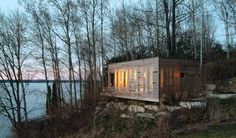 Toronto architect Michael Taylor designed this minimal one-room cabin on Lake Simcoe in Ontario, Canada, to provide just the essentials: a bed, a wood-burning stove and a bathroom with an outdoor shower. A screen of one-by-three-inch horizontal cedar slats lets in filtered light, and a green roof planted with sedums and herbs provides thermal mass that helps keep the cabin cool.