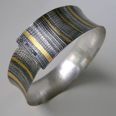 Oxidised silver bangle with gold leaf by Jessica Briggs