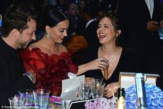 Cheeky! Katy puts her microphone down her friend Dasha Zhukova's top...