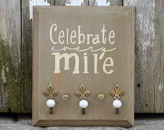 Running Medal Holder - Celebrate Every Mile - Ornate Knobs. $35.00, via Etsy.