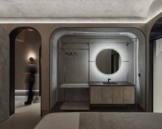 A backlit mirror and indirect hidden lighting creates a calming atmosphere in this treatment room. Hidden Lighting, Strip Lighting, Backlit Mirror, Grey Ceiling, Villa, Indirect Lighting, Massage Room, Treatment Rooms, Light Installation