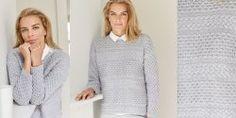 Женский пуловер с косами схема и описание