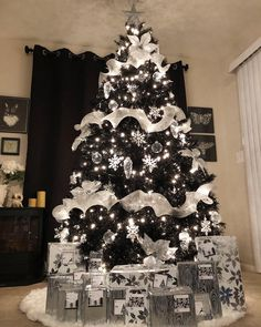 These Stunning Black Christmas Trees Will Convince You to Go Dark This Year Finally! A tree to match my soul. These Stunning Black Christmas Trees Will Convince You to Go Dark This Year Finally! A tree to match my soul. Black Christmas Tree Decorations, Elegant Christmas Trees, Silver Christmas Tree, Ribbon On Christmas Tree, Christmas Diy, Christmas Manger, Black Xmas Tree, Christmas Wreaths, Colorful Christmas Tree