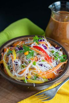 Crisp peppers, cabbage, carrots and cucumber, crunchy peanuts are all tossed together with rice vermicelli and a spicy Thai-style peanut sauce in this Super Crunchy Thai Noodle Salad. #thai #vermicelli #peanutsauce