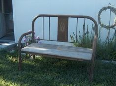 Garden bench made from old iron bed frame and boards.