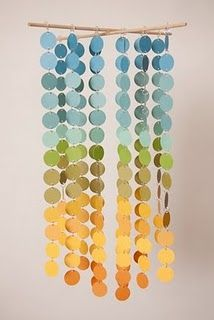 Make using paint chip samples and hole punch.  Would be super cute for a dorm room to add color for basically free !