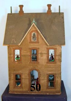 American-made dollhouse in the Gothic Revival style dating from 1875-1880. The house is 41 inches tall (including chimneys), 27 inches wide and 22 1/2 inches deep (including roof).