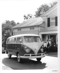 1966 Deluxe VW Bus happy family staring that looks like my family when we got ours in the 60s also.   LOVED that car.....