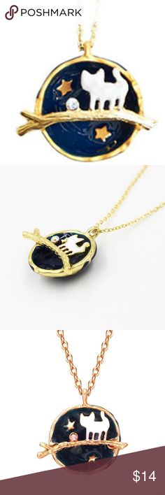 """Navy Globe Kitty Cat Necklace This is an absolutely beautiful necklace. It is a globe cut in half with a kitten or cat sitting on a golden branch with the moon ( an iridescent rhinestone), stars in the background, and cute details. The outside, as shown in photo 4, shows part of the world. It's very cute, very lovely. A great gift for cat lovers or for yourself! It measures 24"""" long with a 3"""" extender. poshnook Jewelry Necklaces"""