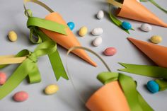 DIY Paper Carrot Treat Bags. Yet another way to hold candy this Easter.