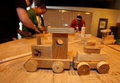A complete toy train one of 10 being built today with the goal of 500 made by Christmas for kids. Focus Hope in Detroit held a DIY workshop with its Reclaim Detroit organization on Saturday, August 11, 2012. The goal was for volunteers to use reclaimed wood from abandoned homes in Detroit and turn them into toy trains for kids to have for Christmas.