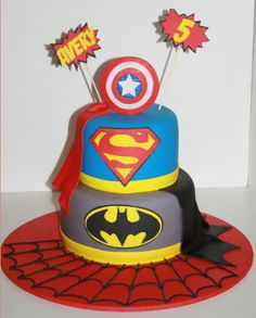 Super Hero Cake - capes hanging onto other layers & shield on top is PERFECT!