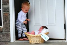 Big brother and newborn baby photography idea