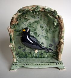 """""""Blackbird in a Bower"""" by Terry Shone (earthenware with enamel, lustre and coloured glazes)"""