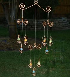 better, total view... Solid Copper Glass Mobile Suncatcher Handcrafted by TwistsOnWire. $34.00, via Etsy.