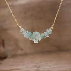 Raw Aquamarine Necklace on Gold Raw by AbizaJewelry