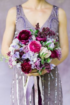 blooming purple and pink wedding bouquet - photo by Amy Nicole Photography