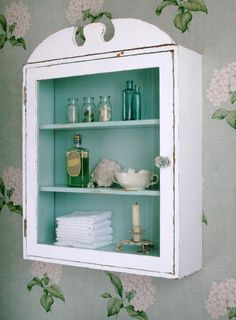 apothecary's chest with antique bottles--ideal for a sweet bathroom or dressing room