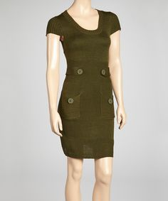 Cozy meets chic in this knit sweater dress. Its short-sleeve silhouette features two charming pockets detailed with oversize buttons.Measurements (size S): 37'' long from high point of shoulder to hem100% acrylicHand wash; tumble dryImported