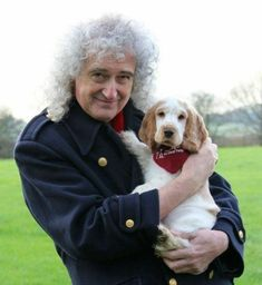 Brian May and Anita Dobson enjoying cuddles with puppies, Ralph (ft. with Brian) and Luke (ft. with Anita), whilst visiting the Buckinghamshire charity, Hearing Dogs for Deaf People. Queen Brian May, I Am A Queen, Save The Queen, John Deacon, Queen Meme, Deaf People, Roger Taylor, Ben Hardy, We Will Rock You