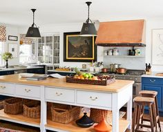 The kitchen of a Long Island home renovated by designer Daniel Sachs and architect Kevin Lindores includes American pendant lights and a bespoke copper hood; the range is by Bertazzoni, and the cabinetry at far right is painted in Farrow & Ball's Ha Painting Kitchen Cabinets, Kitchen Cabinetry, Kitchen Paint, Kitchen Dining, Kitchen Decor, Island Kitchen, Kitchen Ideas, Kitchen Designs, Big Kitchen